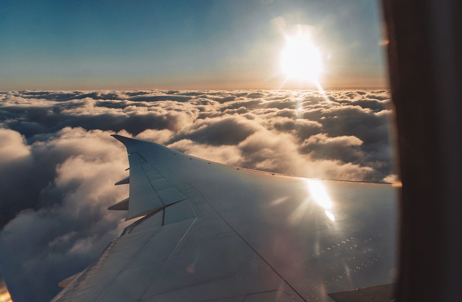 Airplane view: Sunset over clouds