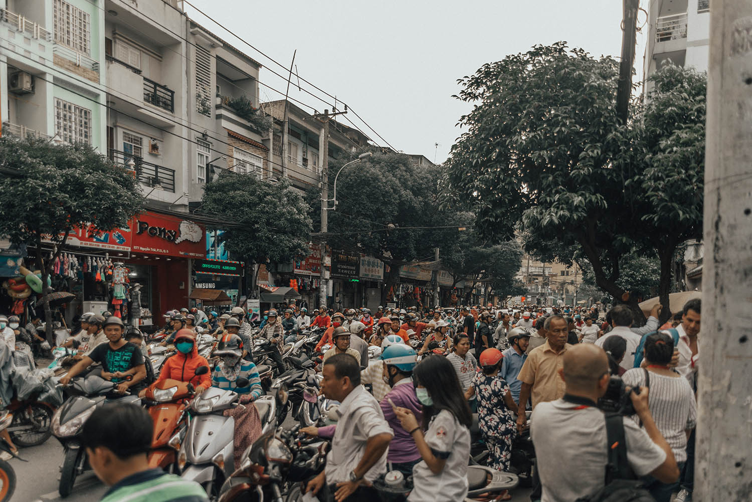 Busy street with mopeds in Ho Chi Minh City, Vietnam